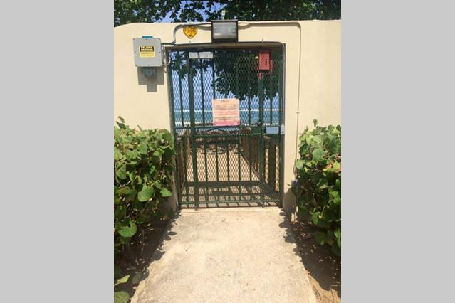 One of the 2 gates to the Private Beach