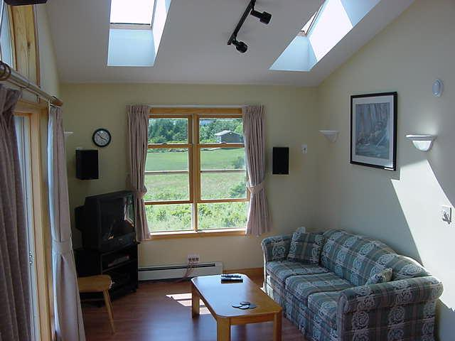 Skylights add natural light to the living and kitchen areas