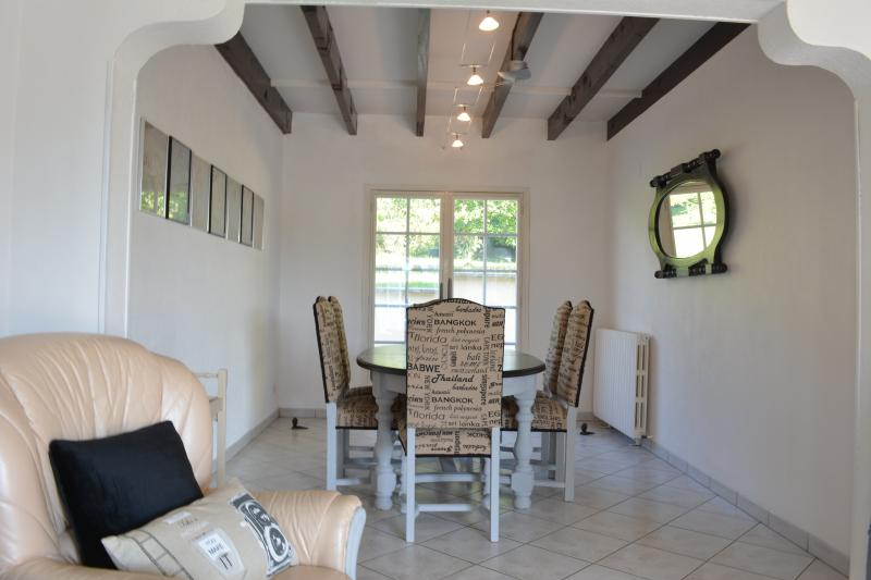 Dining area with access to the rear terrace
