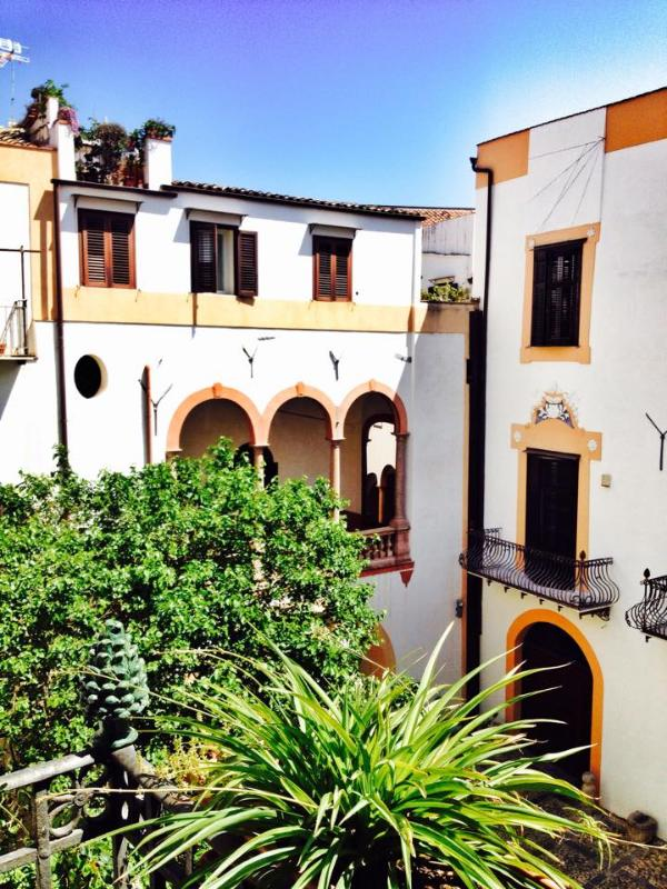 View from the Room's balcony. MUlberry tree and the loggia to the right