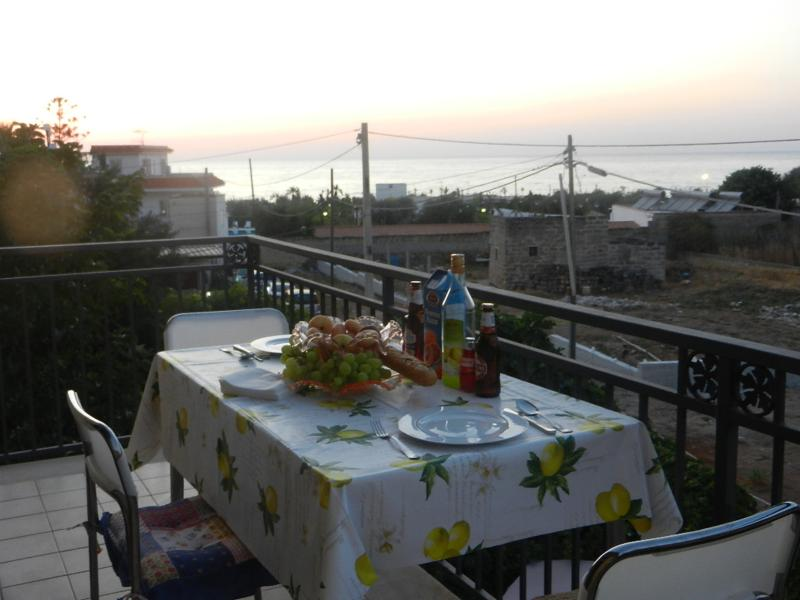 Dinner on balcony with sunset