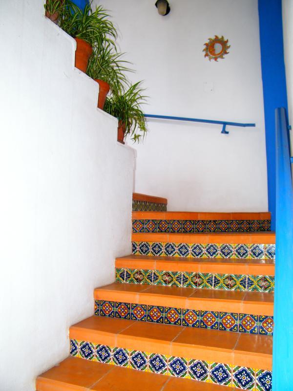 Main stairway to second floor guest rooms.