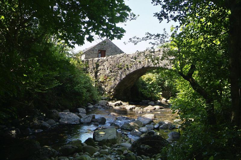 Whillan Beck behind 17th Century Packhorse Bridge