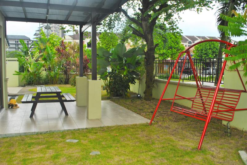 Swing and sitting area under the pergola