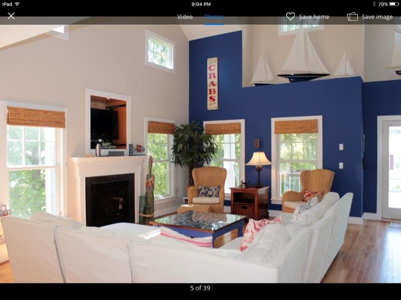two story Great Room, gas fireplace, and entertainment center