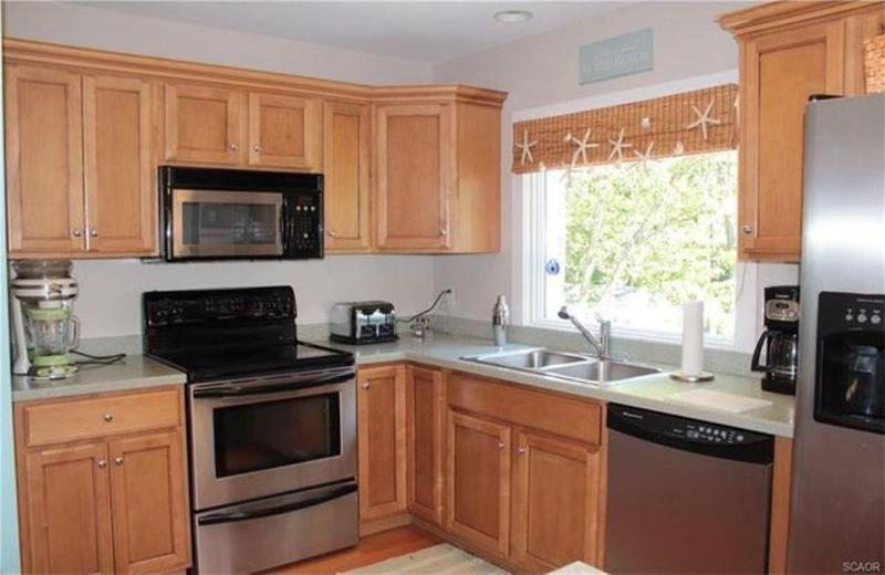 kitchen, solid counter top, stainless appliances, Fully equipped with full cooking utensiles