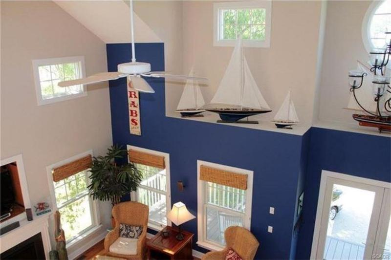 Sunny great room with ceiling fans and 2 zone CAC, heating and cooling