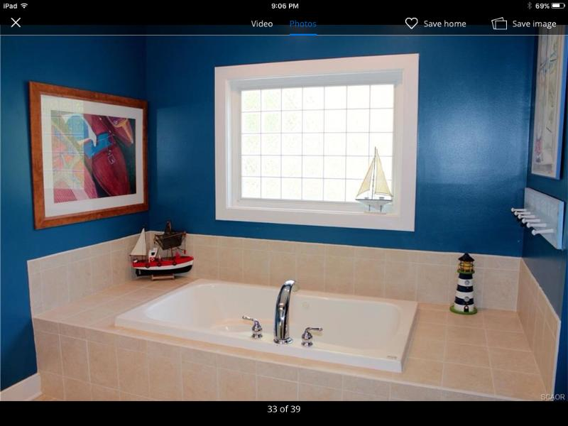 Bathroom with shower and whirlpool soaking tub