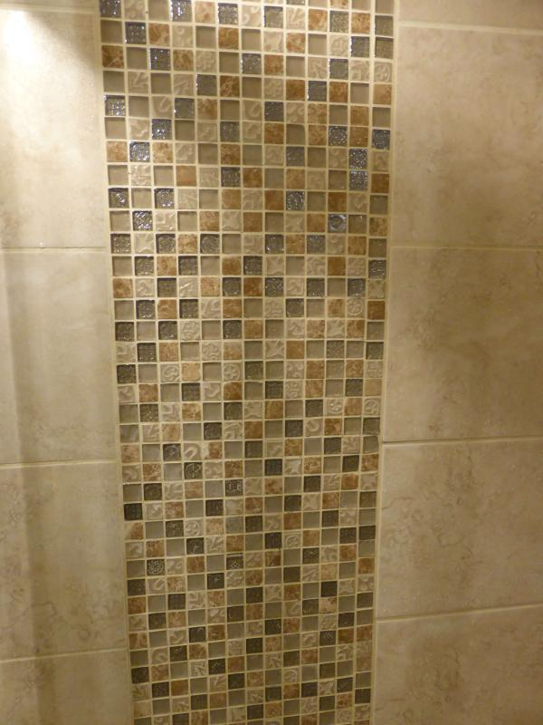 Mosaic tiles in the downstairs family shower room