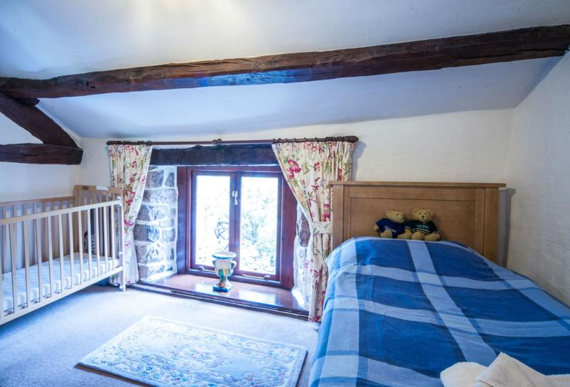 Upstairs snug with single bed and cot