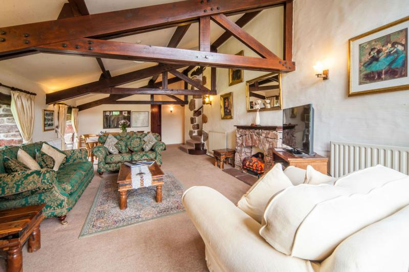 Downstairs 30ft living expanse beneath the beams and high ceiling!