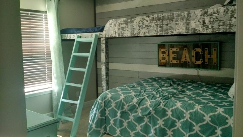 Third bedroom features queen bed, bunk bed with 2 twin beds and a twin pull out trundle