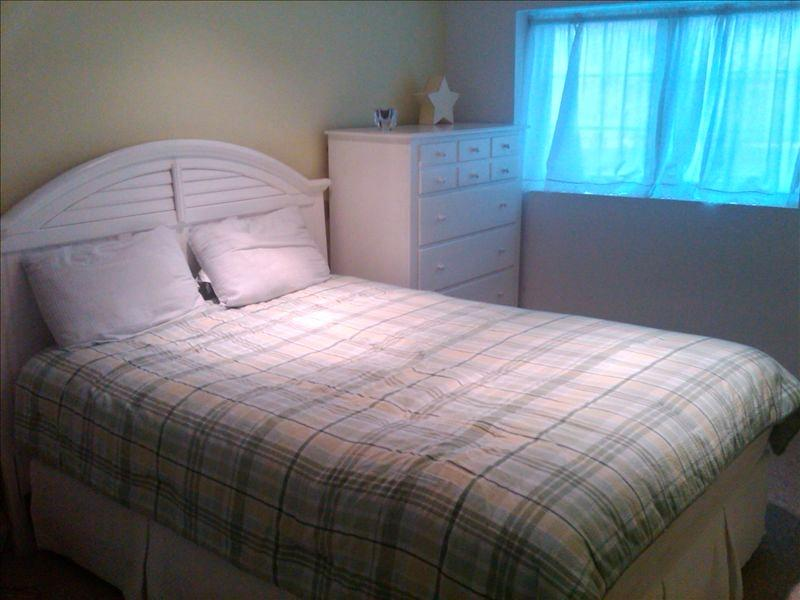 Downstairs Bedroom, with full bath. Comfortable Sterns and Foster Mattresses on all beds in home.