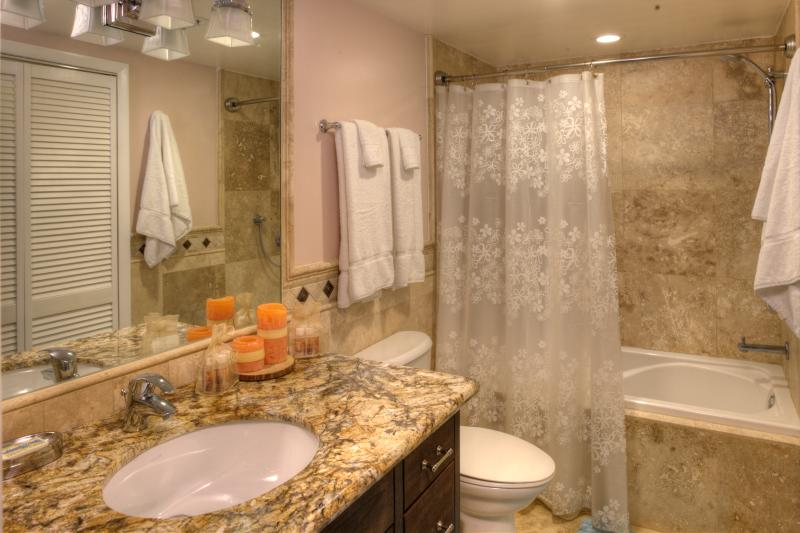 Guest Bathroom - light, bright, and so pleasant. And there's a packed Linen closet too.