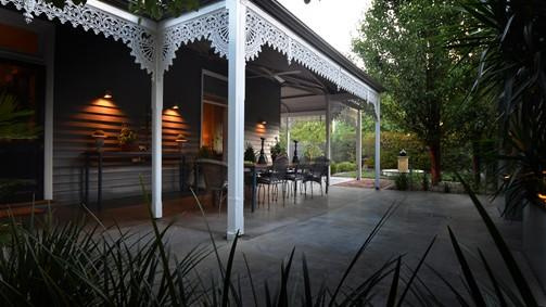 Under the side verandah there is a large dining table  for outdoor entertaining.