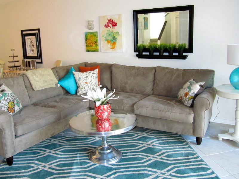 Updated and colorful our casual comfortable sitting room w/ 52' flatscreen Smart TV.