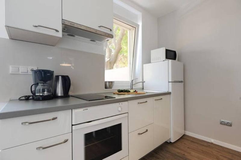 Modern soft-close kitchen, sea view