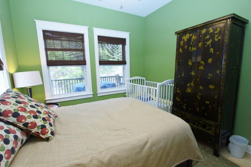 Second Floor Queen Showing Crib and Armoire