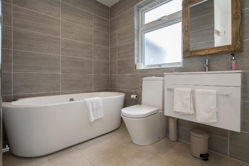 Spacious family bathroom with large bath and separate shower enclosure