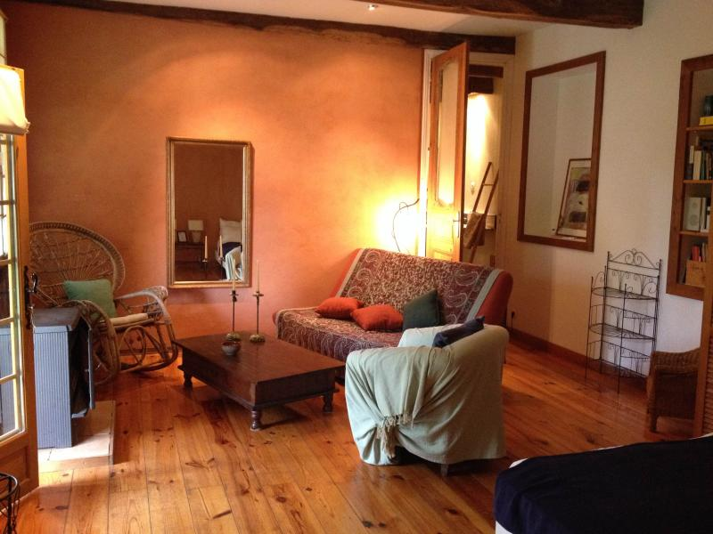 Bedroom 1. with wood burning stove and sofabed. Room for 4 people.