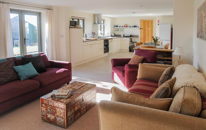 View of open plan living area.