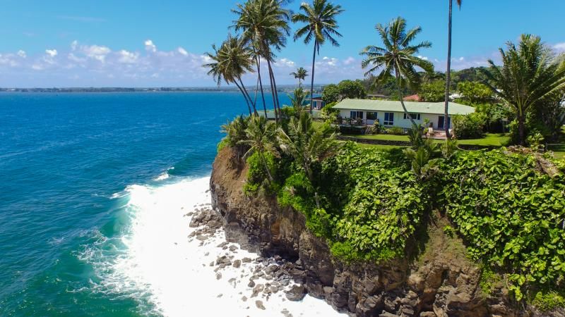 Our house sits on this oceanfront promontory, with views of Honolii Cove and Hilo Bay.