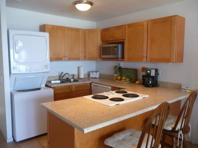 Kitchen with dishwasher and clothes washer/dryer
