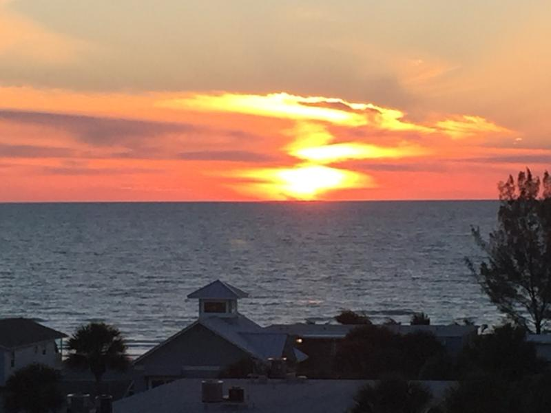 View of sunset  over the Gulf from front door of condo