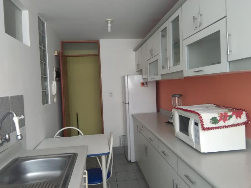 Kitchen with, plus a small dining area, all appliances and laundry area