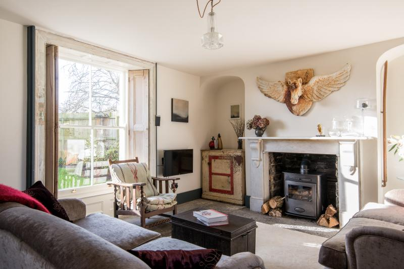 Godney Arts House sunny living room with views over the cottage garden