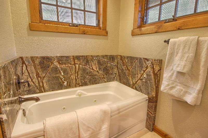 Jetted Bathtub, Marble Surround, Soak in Provided Soothing Salts