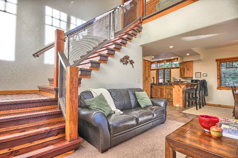 Artistic Staircase Leads From Great Room to Upper Level