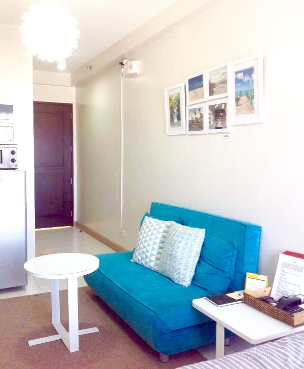 Sofa bed with 2 side table for eating, lounging and sleeping. Emergency lights near exit way.
