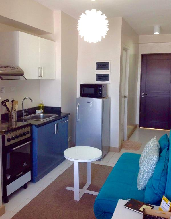 Kitchen corner with basic equipment's.full electric stove with oven,microwave oven,electric kettle