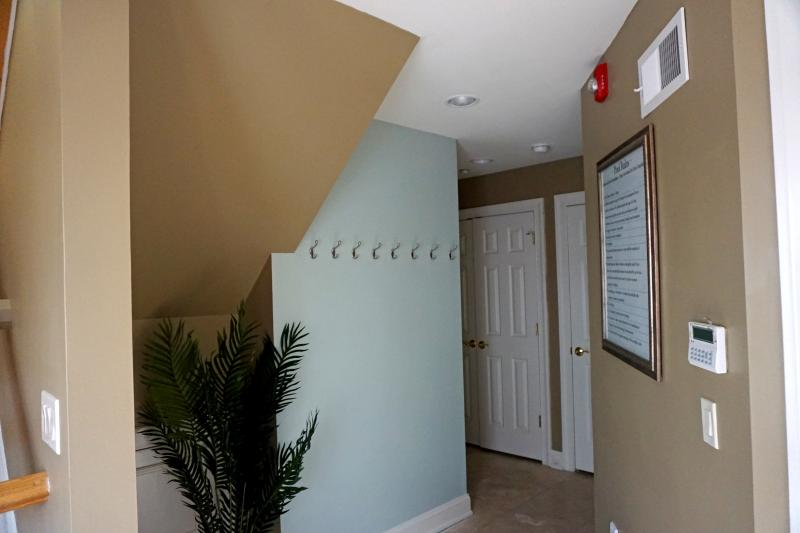 Entry foyer with inside beach shower and full washer dryer