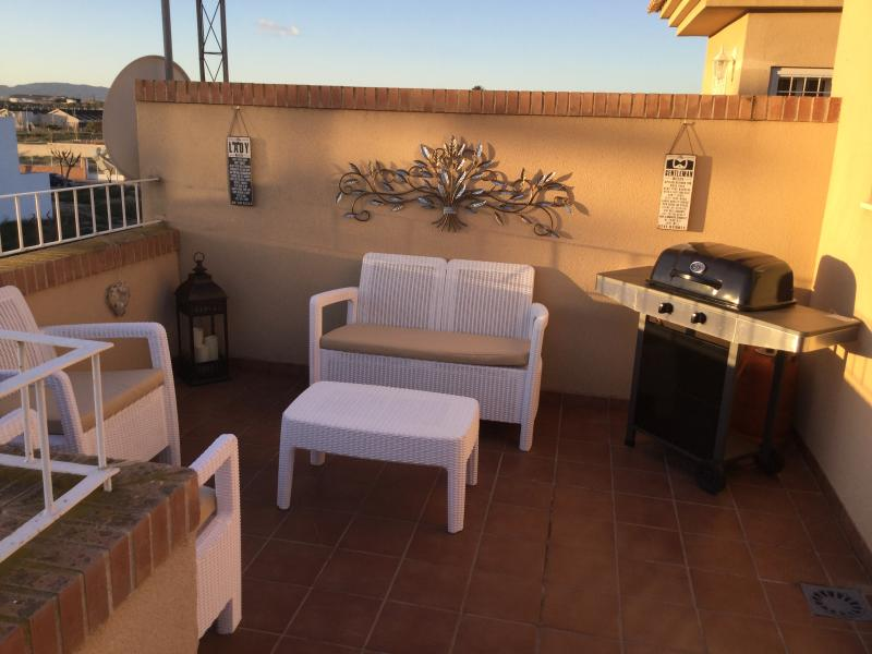 This is the private sun terrace complete with sun loungers, table and chairs and a gas BBQ.