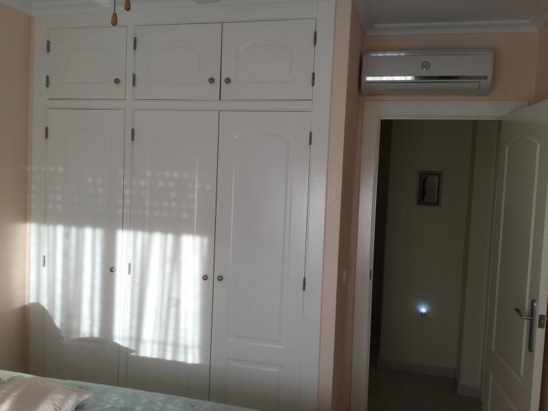 Twin bedded room. Showing the aircon unit and wardrobes