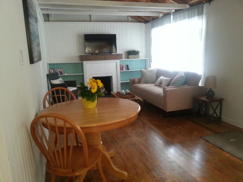 Large dining and living space with flat screen TV and DVD