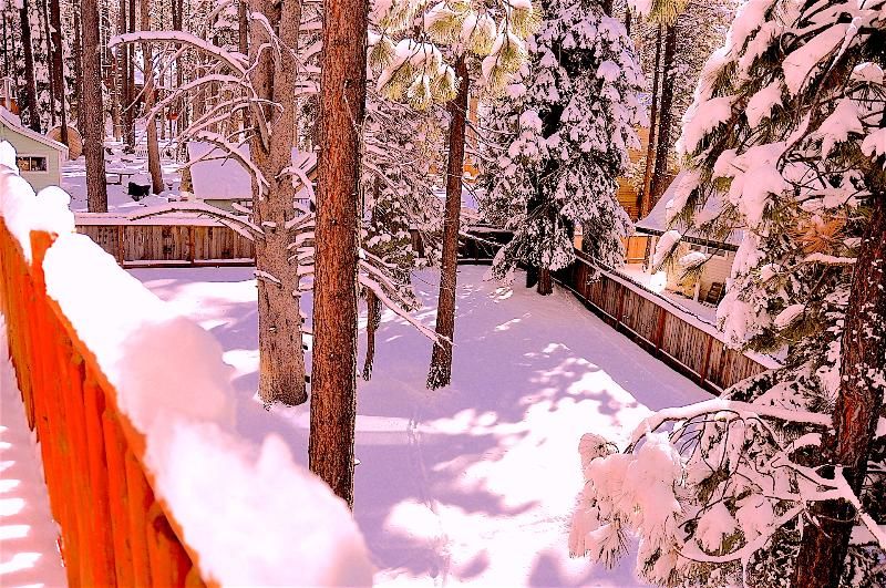 Deck View - birds eye view of a fairly size backyard with fresh powder snow