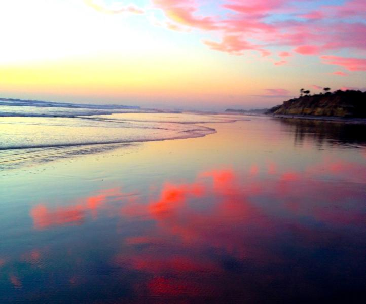magnificent sunset colors reflected on the sand