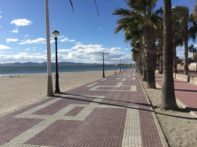 The flat promenade and beach. This a great place for a stroll and a relaxing beer or sangria.