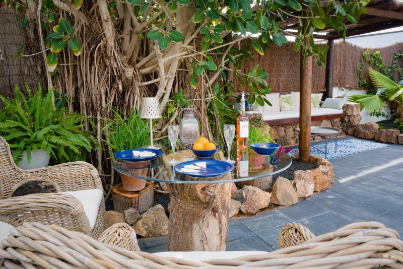 Enjoy dining outdoors at our recycled tree trunk table