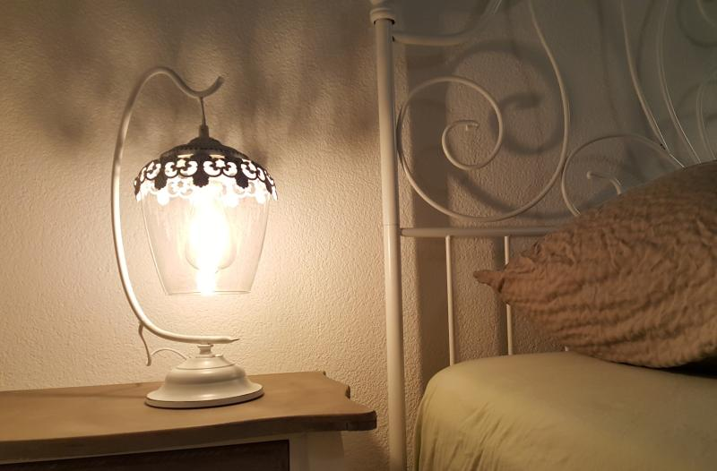 Stylish lamp. Boxspring bed, down bed linen, anallergic protection