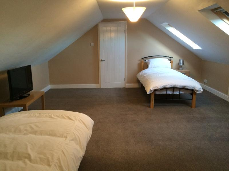 Bedroom 5:  2 single beds, flatscreen t.v