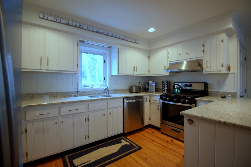 Gas range and well stocked kitchen for cooking and entertaining
