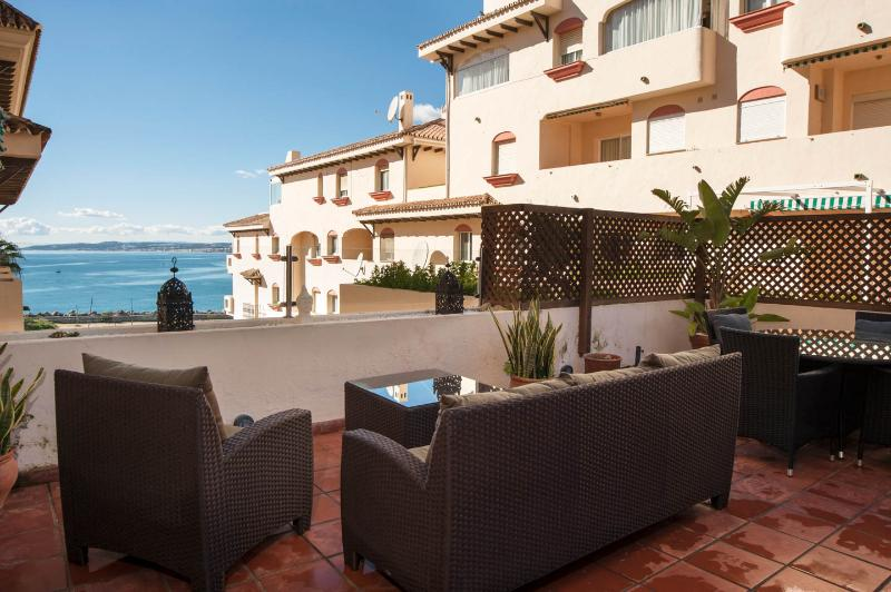 Enjoy the comfortable seating with sea views on the sun terrace.