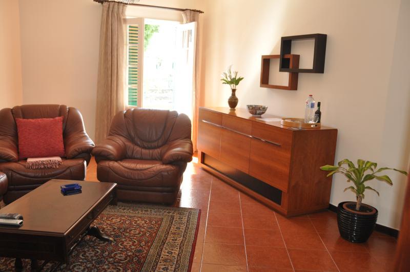 Living area. Door to the balcony.