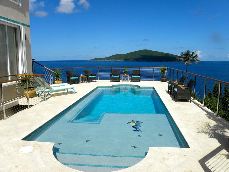 11 x 32 ft. pool features spectacular 180 degree views of surrounding islands.