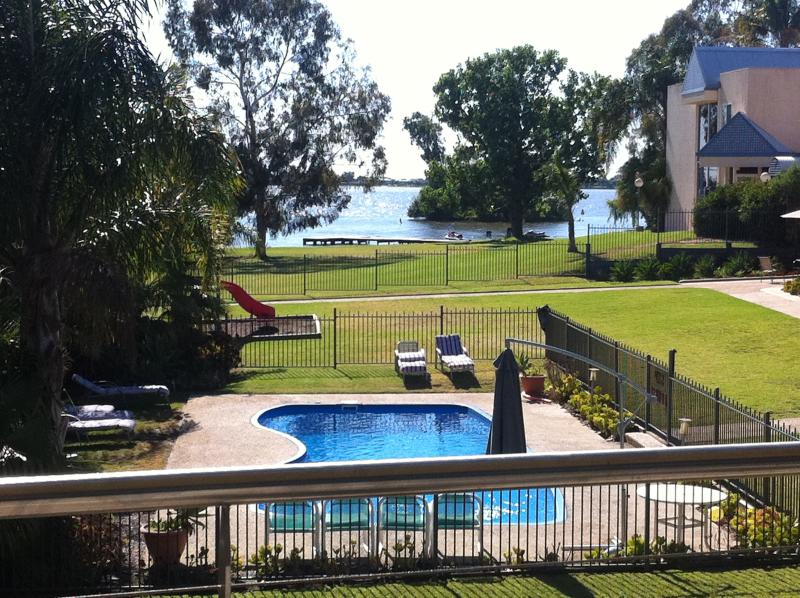 Balcony View - a fantastic location with pool and lake outside your door.