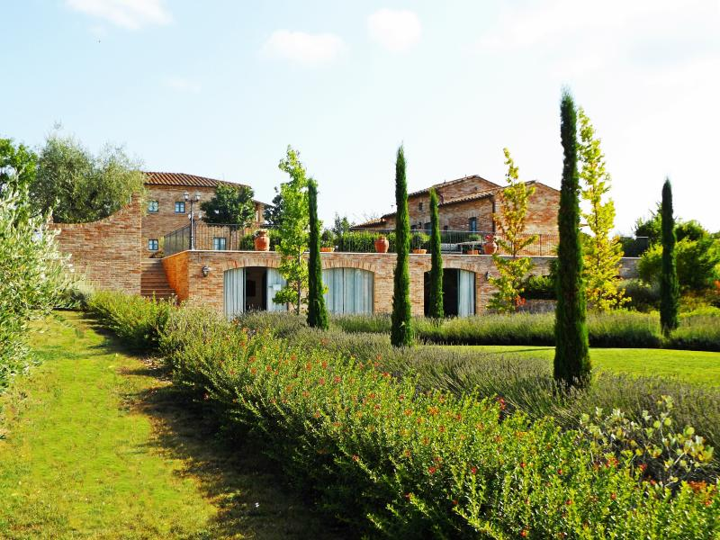 La Fiorita Farmhouse in Cortona overlooked from the olive grove.